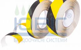 Предупреждающая противоскользящая лента Черно-желтая Рулон фото